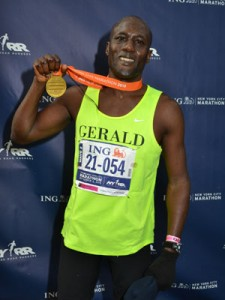 Gerald Gakundi with a medal